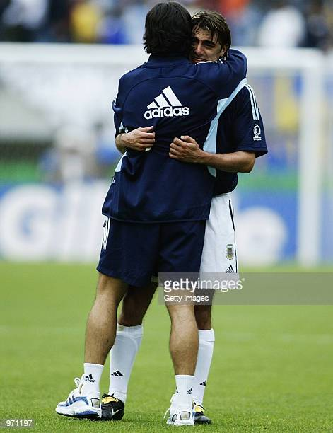 Claudio Lopez of Argentina is consoled after the Argentina v Sweden Group F World Cup Group Stage match played at the Miyagi Stadium Miyagi Japan on...