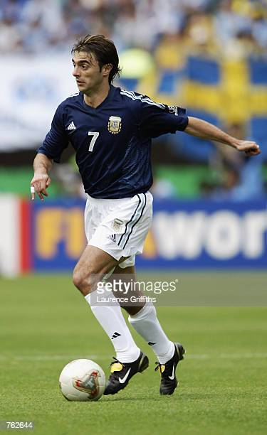 Claudio Lopez of Argentina runs with the ball during the FIFA World Cup Finals 2002 Group F match between Argentina and Sweden played at the Miyagi...