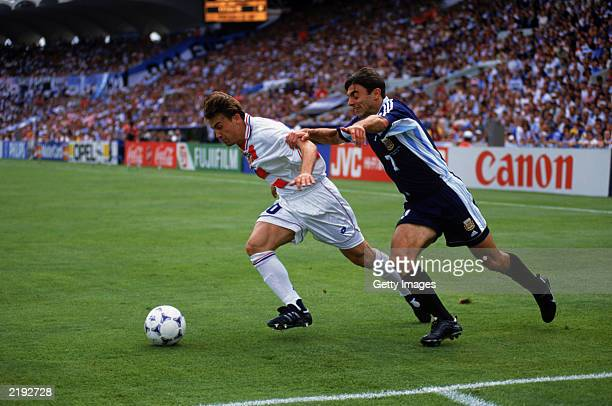 Claudio Lopez of Argentina struggles to get past Dario Simic of Croatia during the FIFA World Cup Finals 1998 Group H match between Croatia and...
