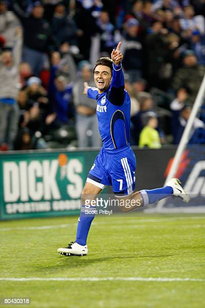 Claudio Lopez of the Kansas City Wizards celebrates his first goal as a KC Wizard against DC United during the game at Community America Ballpark on...