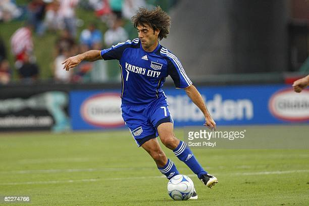 Claudio Lopez of the Kansas City Wizards dribbles the ball against Chivas USA during the game at Community America Ballpark on August 9 2008 in...