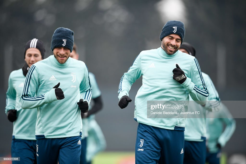 Claudio Marchisio and Andrea Barzagli during a Juventus Training Session at Juventus Center Vinovo on December 31, 2017 in Vinovo, Italy.