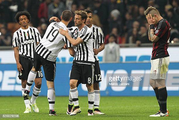 Claudio Marchisio and Leonardo Bonucci of Juventus FC celebrates a victory at the end of the Serie A match between AC Milan and Juventus FC at Stadio...