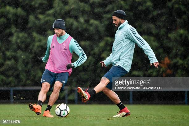 Claudio Marchisio and Stefano Sturaro during a Juventus training session at Juventus Center Vinovo on March 15 2018 in Vinovo Italy