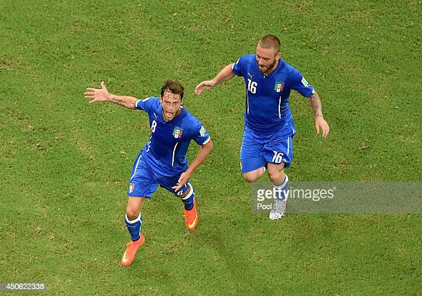Claudio Marchisio of Italy celebrates scoring his team's first goal with Daniele De Rossi during the 2014 FIFA World Cup Brazil Group D match between...