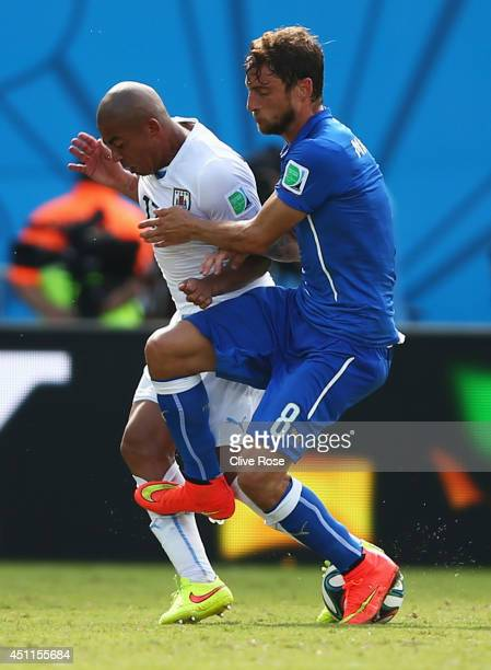 Claudio Marchisio of Italy fouls Egidio Arevalo Rios of Uruguay and is sent off during the 2014 FIFA World Cup Brazil Group D match between Italy and...