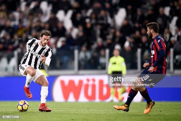Claudio Marchisio of Juventus and Andrea Barberis of Crotone in action during the Serie A match between Juventus and FC Crotone at Allianz Stadium on...
