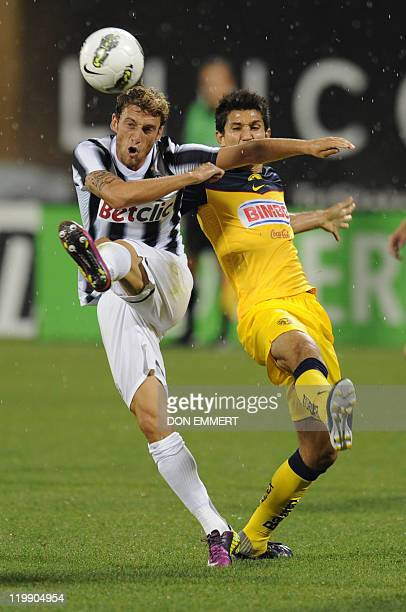 Claudio Marchisio of Juventus and Jesus Molina of Club America go after the ball during the Herbalife World Football Challenge match between Club...