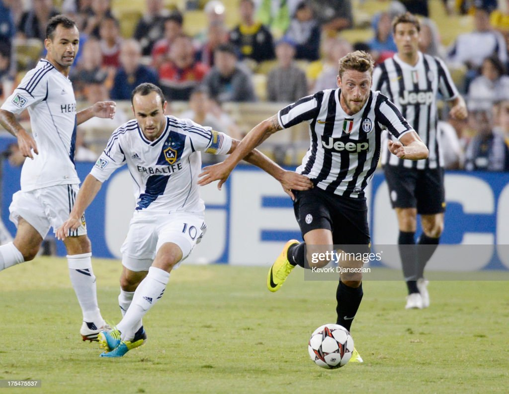 Claudio Marchisio #8 of Juventus and Landon Donovan #10 of the Los Angeles Galaxy battle for the ball during the second half of the 2013 Guinness International Champions Cup at Dodger Stadium on August 3, 2013 in Los Angeles, California