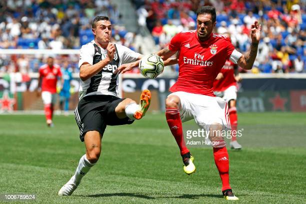 Claudio Marchisio of Juventus battles for the ball with Jardel of Benfica during the International Champions Cup 2018 match between Benfica and...