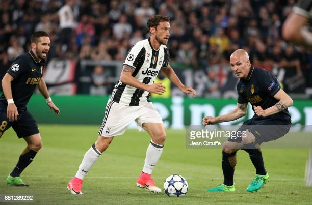 Claudio Marchisio of Juventus between Joao Moutinho and Andrea Raggi of Monaco during the UEFA Champions League semi final second leg match between...