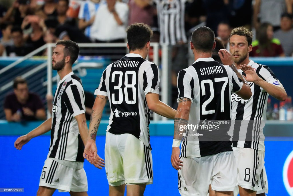 Claudio Marchisio #8 of Juventus celebrates his goal with teammates in the second half against the Paris Saint-Germain during their International Champions Cup 2017 match at Hard Rock Stadium on July 26, 2017 in Miami Gardens, Florida.