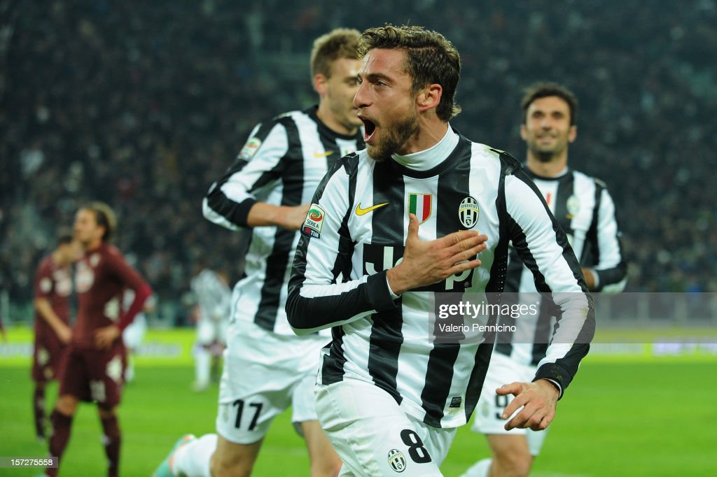 Claudio Marchisio (C) of Juventus celebrates the opening goal during the Serie A match between Juventus and Torino FC at Juventus Arena on December 1, 2012 in Turin, Italy.