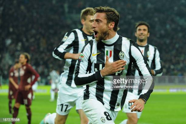 Claudio Marchisio of Juventus celebrates the opening goal during the Serie A match between Juventus and Torino FC at Juventus Arena on December 1...