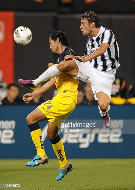 Claudio Marchisio of Juventus challenged Daniel Marquez of Club America during the Herbalife World Football Challenge match between Club America and...