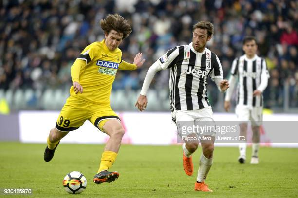 Claudio Marchisio of Juventus competes for the ball with Andija Balic of Udinese Calcio during the serie A match between Juventus and Udinese Calcio...