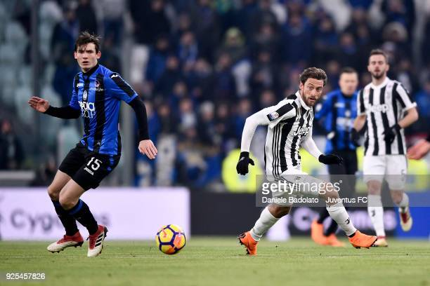 Claudio Marchisio of Juventus competes for the ball with Marten De Roon of Atalanta BC during the TIM Cup match between Juventus and Atalanta BC at...