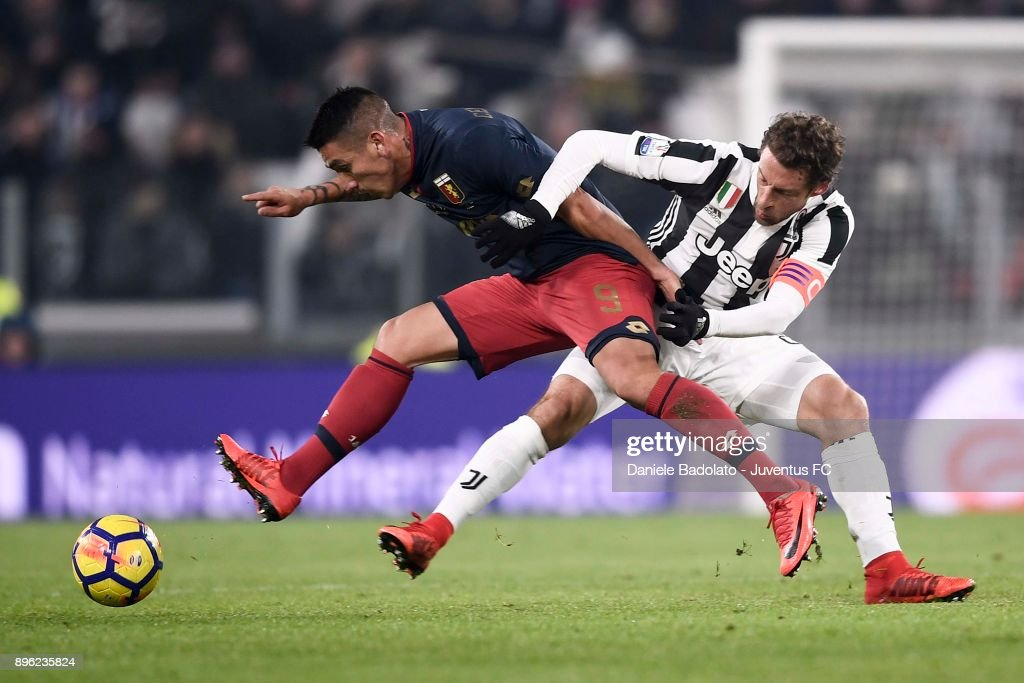 Claudio Marchisio of Juventus competes for the ball with Ricardo Centurion of Genoa CFC during the TIM Cup match between Juventus and Genoa CFC at Allianz Stadium on December 20, 2017 in Turin, Italy.