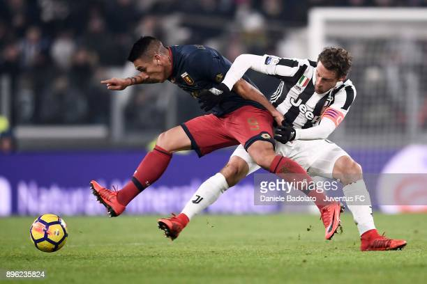 Claudio Marchisio of Juventus competes for the ball with Ricardo Centurion of Genoa CFC during the TIM Cup match between Juventus and Genoa CFC at...