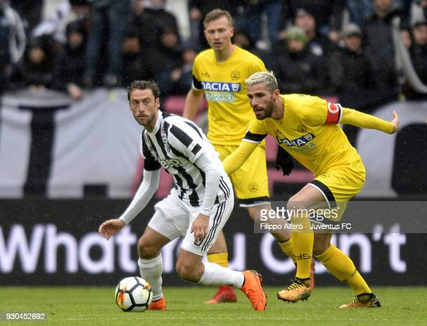 Claudio Marchisio of Juventus competes for the ball with Valon Bahrami of Udinese Calcio during the serie A match between Juventus and Udinese Calcio...