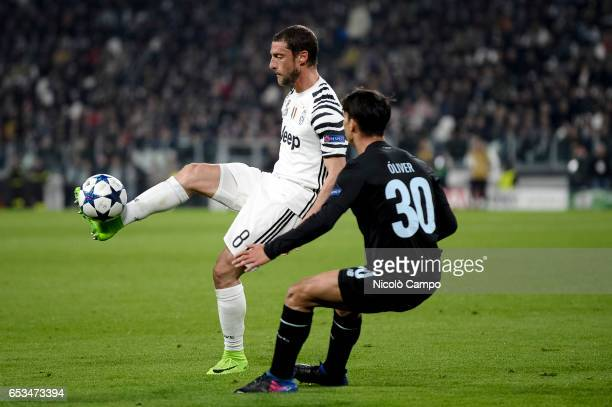 Claudio Marchisio of Juventus FC and Oliver Torres of FC Porto compete for the ball during the UEFA Champions League football match between Juventus...
