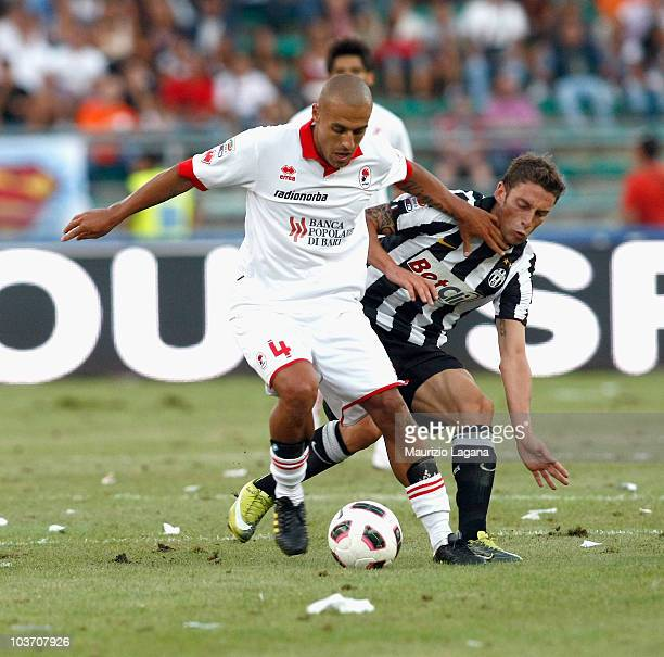 Claudio Marchisio of Juventus FC battles for the ball with Sergio Almiron of AS Bari during the Serie A match between Bari and Juventus at Stadio San...