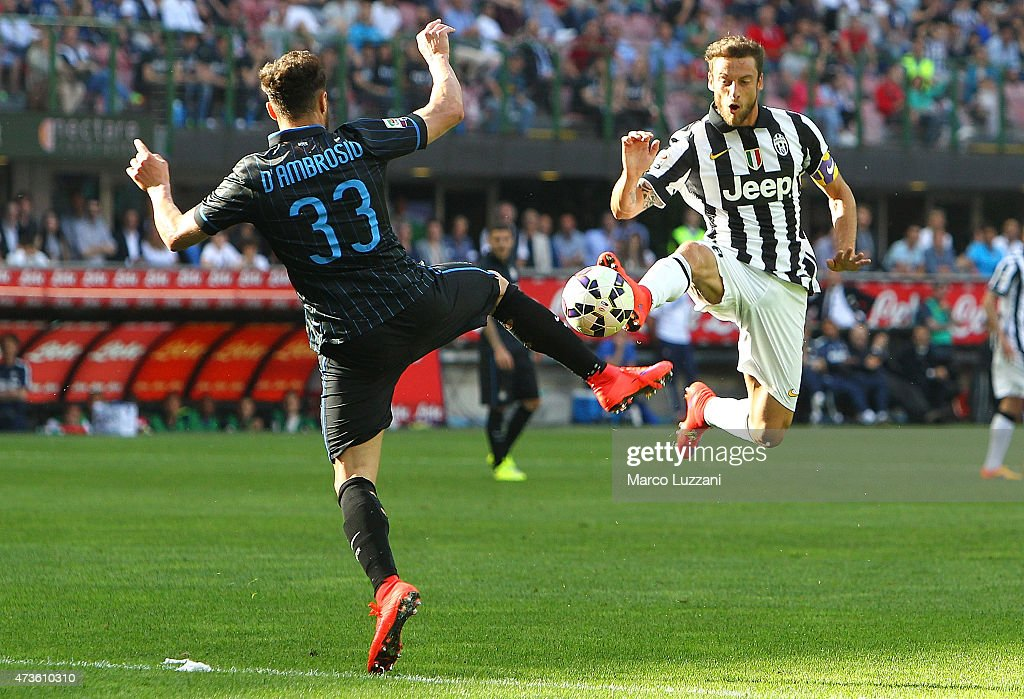 Claudio Marchisio (R) of Juventus FC competes for the ball with Danilo D Amombrosio (L) of FC Internazionale Milano during the Serie A match between FC Internazionale Milano and Juventus FC at Stadio Giuseppe Meazza on May 16, 2015 in Milan, Italy.