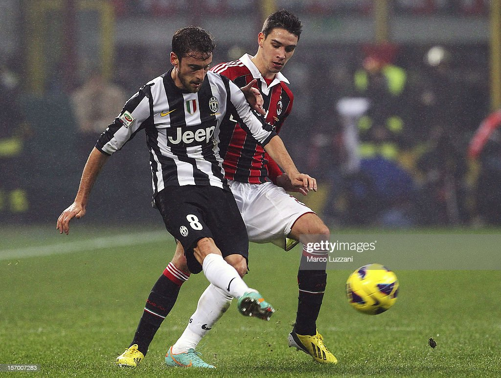 Claudio Marchisio of Juventus FC competes for the ball with Mattia De Sciglio of AC Milan during the Serie A match between AC Milan and Juventus FC at San Siro Stadium on November 25, 2012 in Milan, Italy.