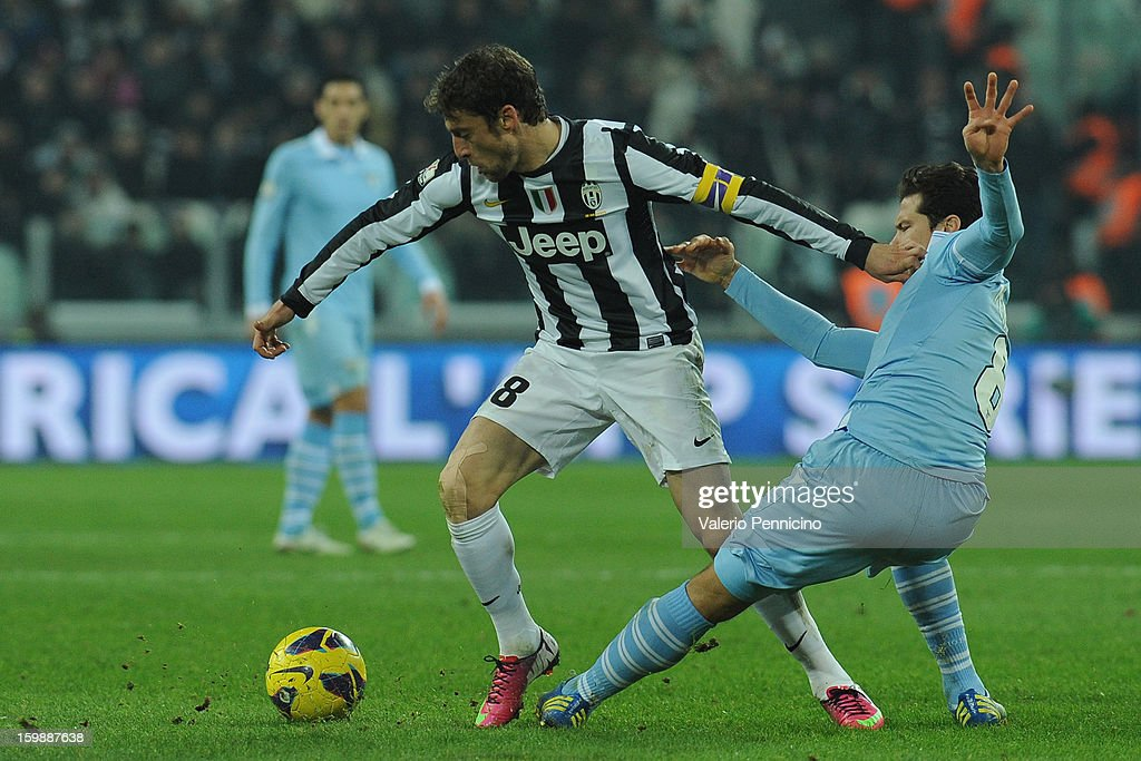 Claudio Marchisio (L) of Juventus FC competes with Anderson Hernanes of S.S. Lazio during the TIM cup match between Juventus FC and S.S. Lazio at Juventus Arena on January 22, 2013 in Turin, Italy.