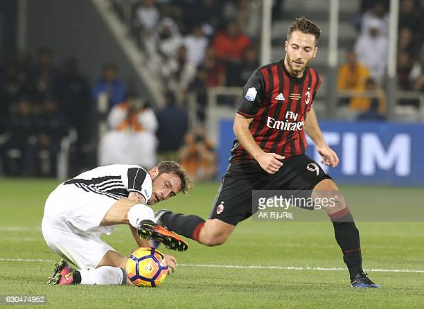 Claudio Marchisio of Juventus FC in action against Andrea Bertolacci of AC Milan during the Supercoppa TIM Doha 2016 match between Juventus FC and AC...