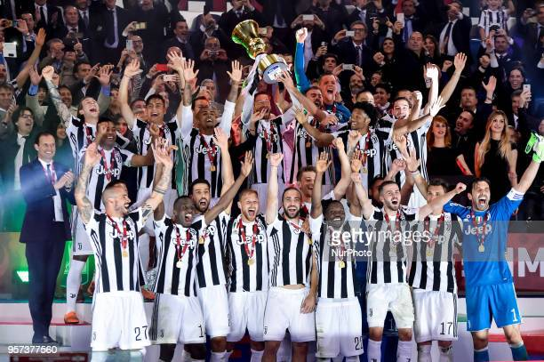 Claudio Marchisio of Juventus raises the trophy after the TIM Cup Coppa Italia final match between Juventus and AC Milan at Stadio Olimpico Rome...