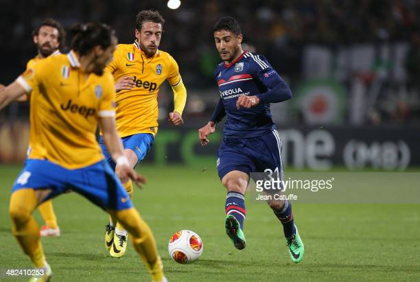 Claudio Marchisio of Juventus Turin and Nabil Fekir of Lyon in action during the UEFA Europa League quarter final match between Olympique Lyonnais OL...