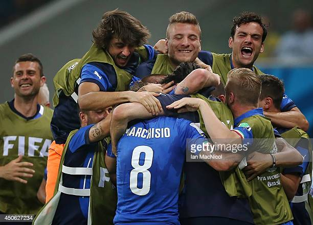 Claudio Marchisio runs to celebrate with the bench after scoring during the opening Group D match of the 2014 World Cup between England and Italy at...