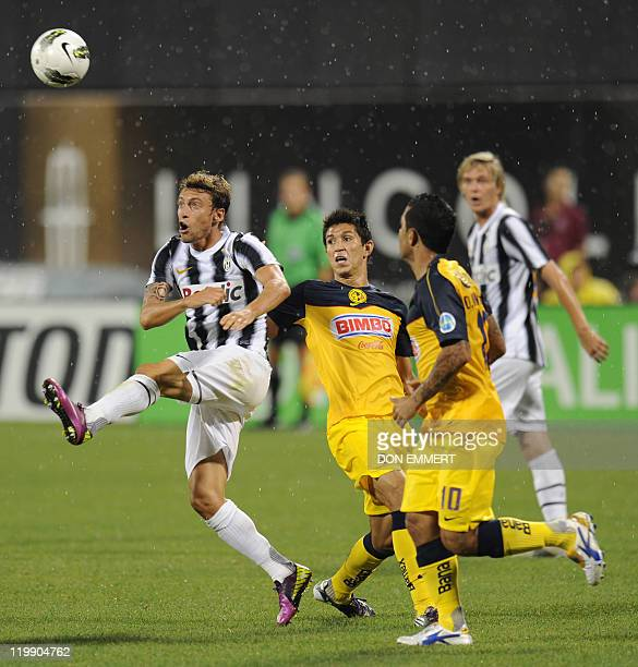Claudio Marchiso of Juventus moves the ball before Jesus Molina of Club America during their Herbalife World Football Challenge on July 26 2011 at...