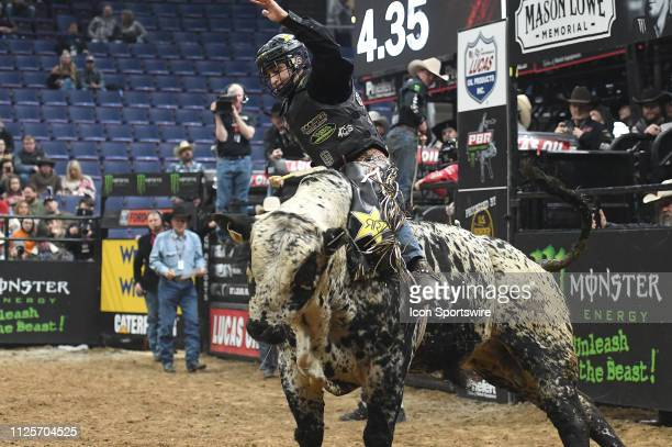 Claudio Montanha Jr rides the bull Blue Magic during the Professional Bullriders Mason Lowe Memorial on February 16 at Enterprise Center St Louis MO