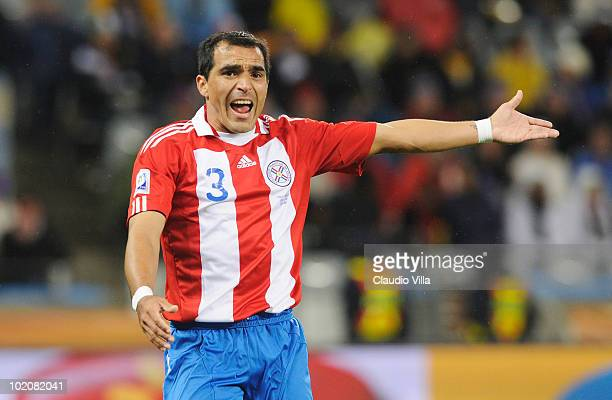 Claudio Morel of Paraguay calls to his team mates during the 2010 FIFA World Cup South Africa Group F match between Italy and Paraguay at Green Point...