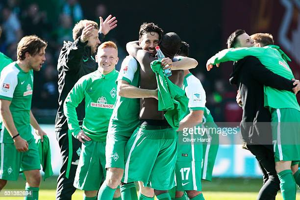 Claudio Pizarro and Anthony Ujah of Bremen celebrate after the Bundesliga match SV Werder Bremen and Eintracht Frankfurt at Weserstadion on May 14...