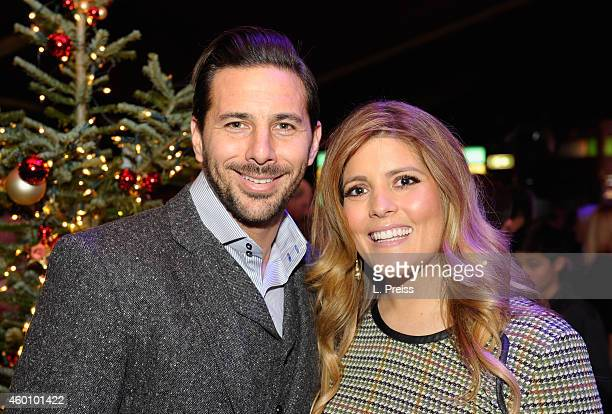 Claudio Pizarro and his wife Karla Salcedo attend the FC Bayern Muenchen Christmas Party at Schubeck's Teatro restaurant on December 7 2014 in Munich...