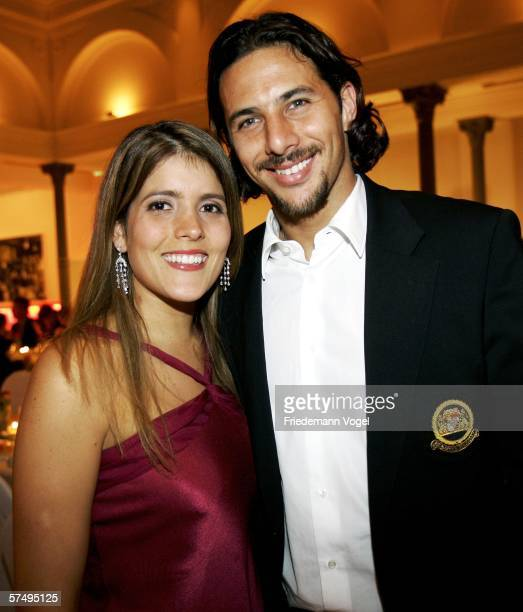 Claudio Pizarro and his wife Karla Salcedo pose for a photo during the Bayern Munich party after the German Cup final between Bayern Munich and...