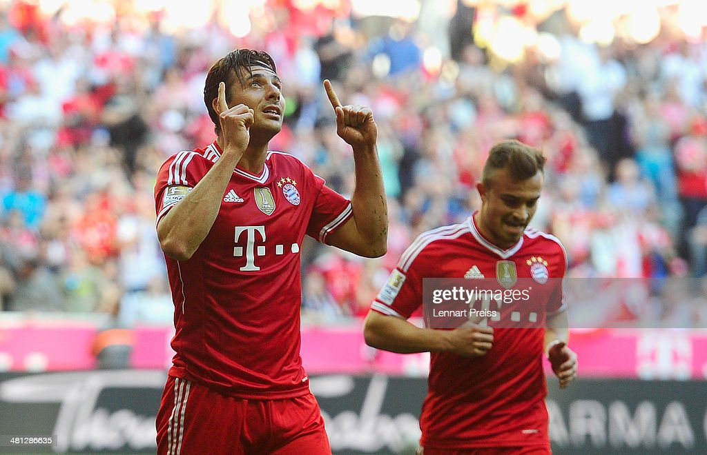 Claudio Pizarro (L) and Xherdan Shaqiri of Muenchen celebrate a goal during the Bundesliga match between FC Bayern Muenchen and 1899 Hoffenheim at Allianz Arena on March 29, 2014 in Munich, Germany.