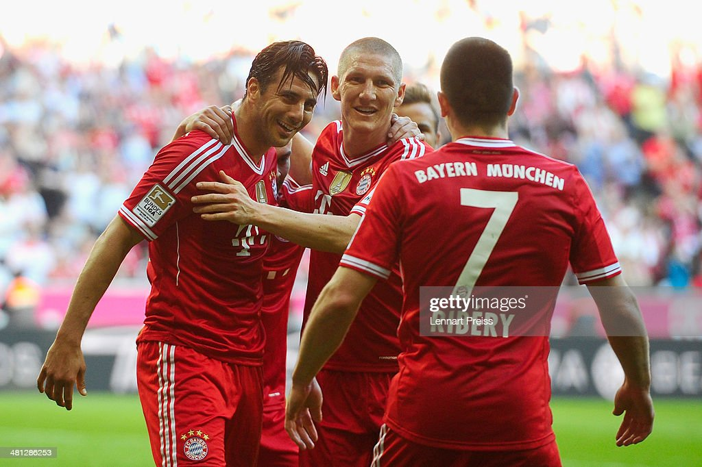 Claudio Pizarro (L-R), Bastian Schweinsteiger and Franck Ribery of Muenchen celebrate a goal during the Bundesliga match between FC Bayern Muenchen and 1899 Hoffenheim at Allianz Arena on March 29, 2014 in Munich, Germany.