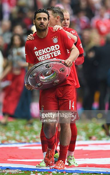 Claudio Pizarro celebrates after winning the league after the Bundesliga match between FC Bayern Muenchen and 1. FSV Mainz at Allianz Arena on May...