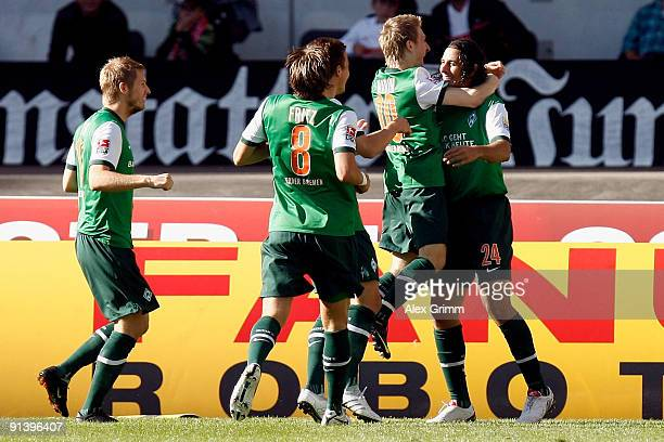 Claudio Pizarro celebrates scoring his team's first goal with team mates Marko Marin Mesut Oezil Clemens Fritz and Aaron Hunt of Bremen during the...
