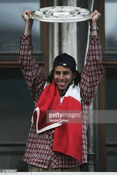 Claudio Pizarro celebrates with the Bundesliga champions trophy during the Bayern Munich champions party at the Marienplatz Square on May 13 2006 in...