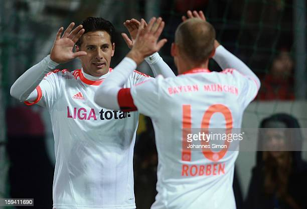 Claudio Pizarro of Bayern celebrates with team mate Arjen Robben after scoring his team's first goal during the friendly game between FC Bayern...