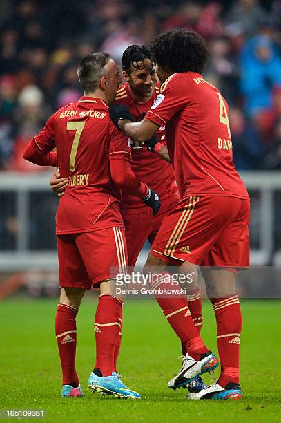 Claudio Pizarro of Bayern Muenchen celebrates scoring his fourth goal and his team's eighth with Franck Ribery and Dante during the Bundesliga match...