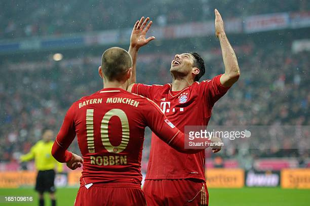 Claudio Pizarro of Bayern Muenchen celebrates scoring his team's sixth goal with Arjen Robben during the Bundesliga match between FC Bayern Muenchen...