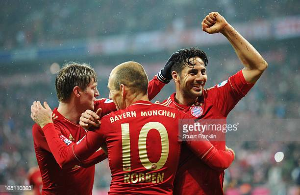 Claudio Pizarro of Bayern Muenchen celebrates scoring his team's sixth goal during the Bundesliga match between FC Bayern Muenchen and Hamburger SV...