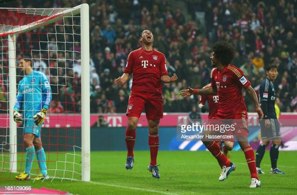 Claudio Pizarro of Bayern Muenchen celebrates scoring the third goal with Dante during the Bundesliga match between FC Bayern Muenchen and Hamburger...