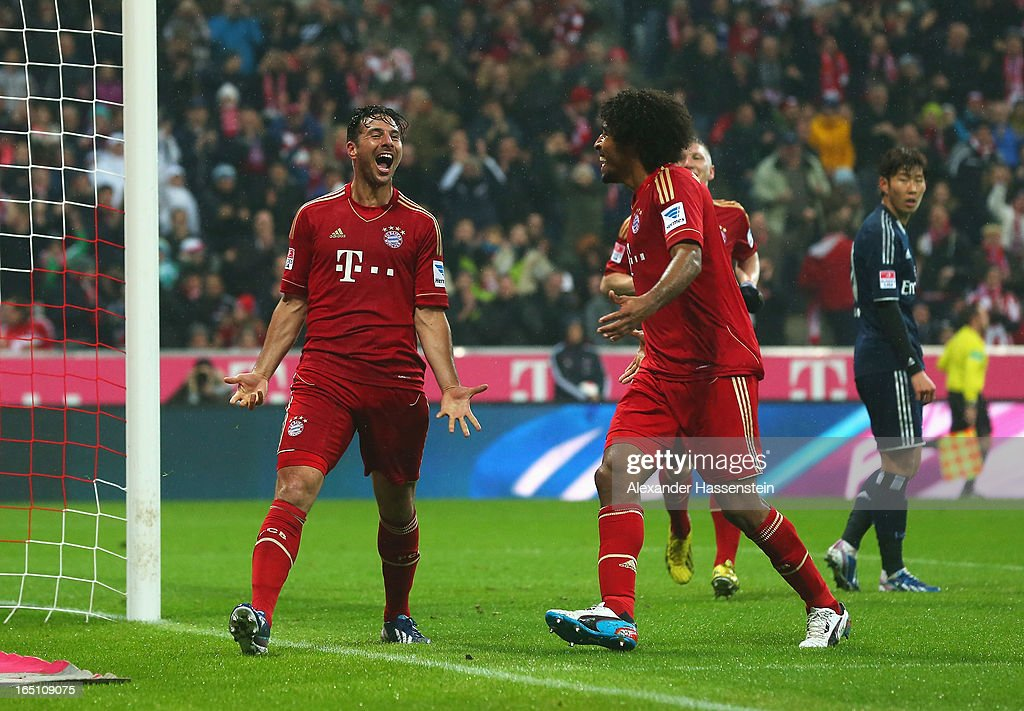 Claudio Pizarro of Bayern Muenchen celebrates scoring the third goal with Dante during the Bundesliga match between FC Bayern Muenchen and Hamburger SV at Allianz Arena on March 30, 2013 in Munich, Germany.